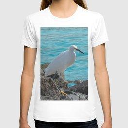 Snowy Egret on Jagged Rocks by Ocean T-shirt