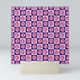 Spinning colourful rings on blue and pink chessboard Mini Art Print