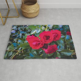 closeup red rose garden with green leaves background Rug