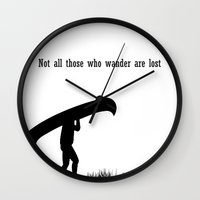 not all those who wander are lost Wall Clocks featuring Not all those who wander are lost by The Happy Taurus
