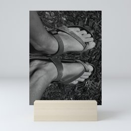 Feet in sandals Mini Art Print