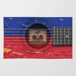 Old Vintage Acoustic Guitar with Haitian Flag Rug