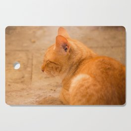 Orange Cat Is Resting On The Terrace  #decor #society6 #homedecor Cutting Board