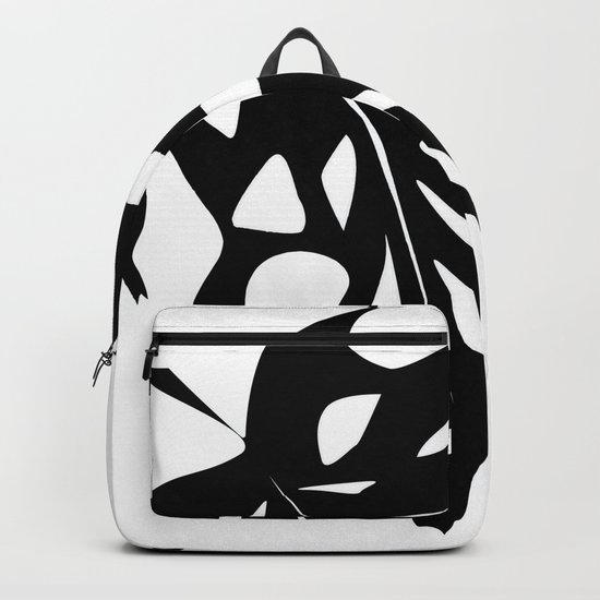 Black leaf monstera on white background . Backpack