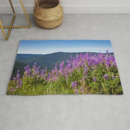 The Lupines in the Hills Rug