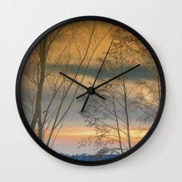 Evening sun over a lake Wall Clock