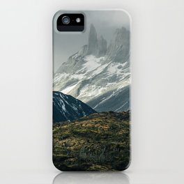 Menacing Mountain peaks with fog coming in iPhone Case