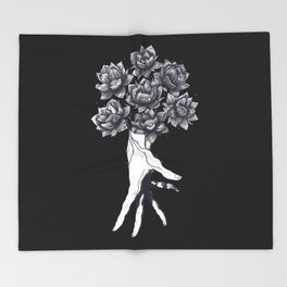 Hand with lotuses on black Throw Blanket
