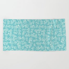 Bikes in a blue background Beach Towel