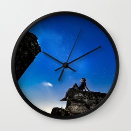Dreaming under starry sky Wall Clock