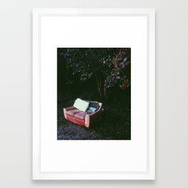 The red couch Framed Art Print
