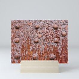 Old riveted metal wall surface Mini Art Print