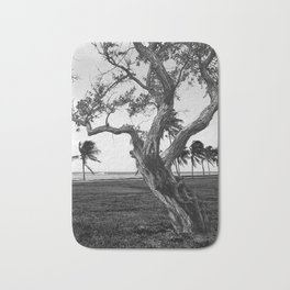 Tree in front of the sea Bath Mat