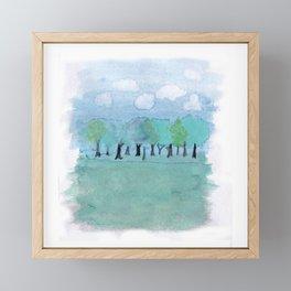 trees under a cloudy sky Framed Mini Art Print