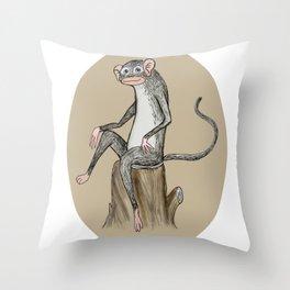 Monkey sitting on a log Throw Pillow