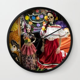 Day of the Dead Altar with Several Skeleton Ladies, Food Offerings, and Marigolds Wall Clock
