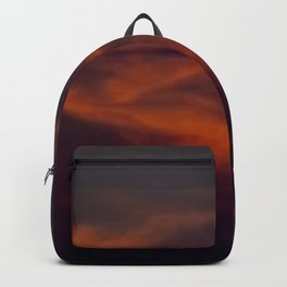 storm annoucement at sunset Backpack