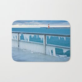 Mole with lighthouse in Warnemuende Bath Mat