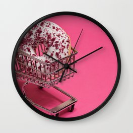 Macro shoot of white donut in shopping trolley over pink background Wall Clock