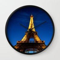 eiffel Wall Clocks featuring Eiffel by Heather Hartley
