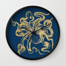 Gold octopus on deep blue background Wall Clock