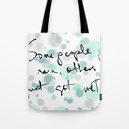 Some people feel the rain, others just get wet -- Bob Dylan. Tote Bag