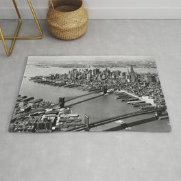 Brooklyn Bridge, Manhattan Bridge  over East River with Manhattan skyline and Hudson River in background black and white photograph Rug