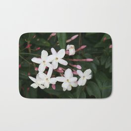 Delicate White Jasmine Blossom with Green Background Bath Mat