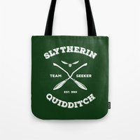 quidditch Tote Bags featuring Slytherin Quidditch Team Seeker: Green by Sharayah Mitchell