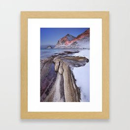 Beach and mountains on the Lofoten in Norway in winter Framed Art Print