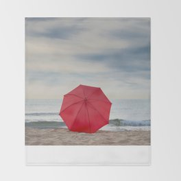 Red umbrella lying at the beach Throw Blanket