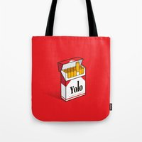 cigarettes Tote Bags featuring YOLO Cigarettes  by RJ Artworks