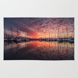Sunset on the Water with Sailboats Rug