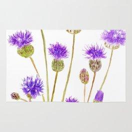 purple thorny wildflower Rug