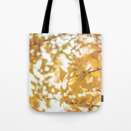 Looking up in yellow Tote Bag