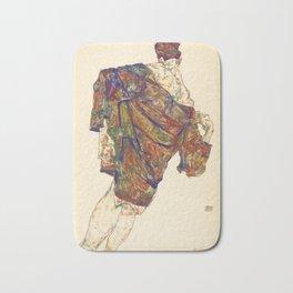 Woman in multicolourd coat by Egon Schielle Bath Mat