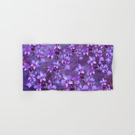purple orchids on a textured wall Hand & Bath Towel