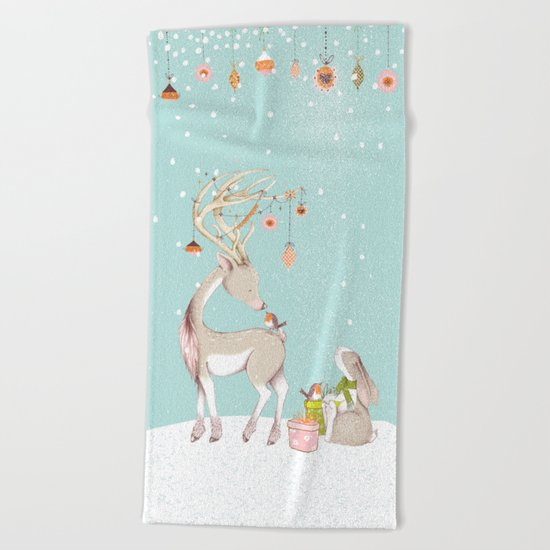 Merry christmas! Little deer decorated with christmasbowls and friends in winter Beach Towel
