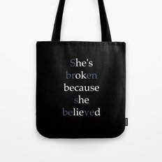 She's Broken because she believed or He's ok because he lied? Tote Bag