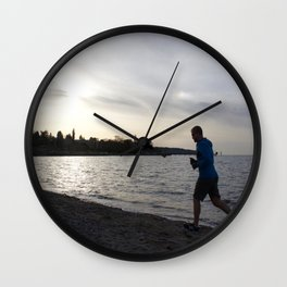 Jogger at Kits Beach During Sunset Wall Clock