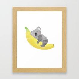 Baby Koala loves Banana Framed Art Print