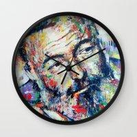 hemingway Wall Clocks featuring Ernest Hemingway by Marta Zawadzka