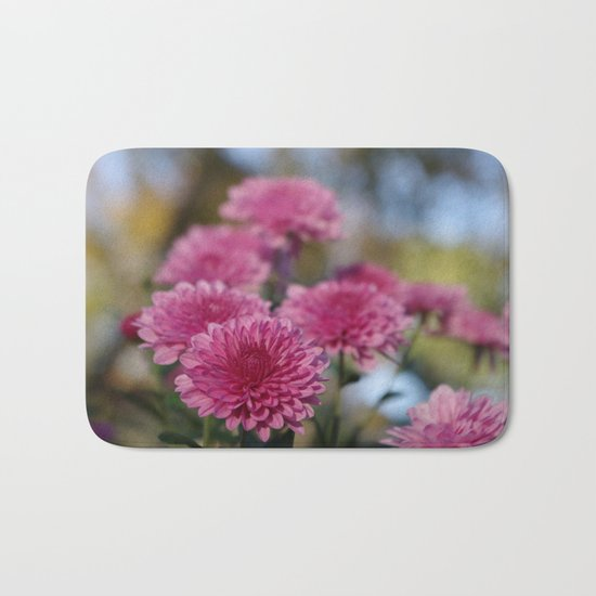 Rosy Chrysanthemum with gold leaves, blue sky Bath Mat