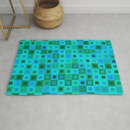 Bright design of light blue intersecting squares and pastel blocks. Rug