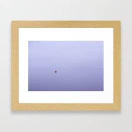 Cloudy sky a bouy reflected in a calm ocean at twilight. Norfolk, UK. Framed Art Print