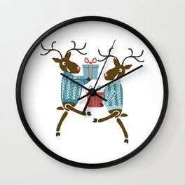 Funny christmas reindeer in sweaters with gifts Wall Clock