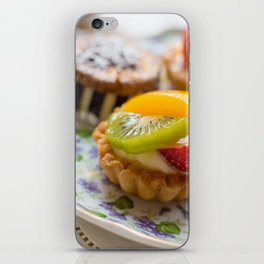 Small fruit tarts laid out on an antique china plate iPhone Skin