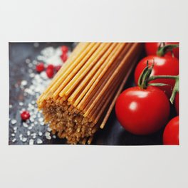 Spaghetti and tomatoes with herbs on an old and vintage wooden table Rug