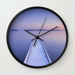 Jetty on a still lake in winter in The Netherlands Wall Clock