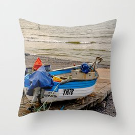 View from behind of a traditional crab fishing boat on the slipway on Sheringham beach Throw Pillow